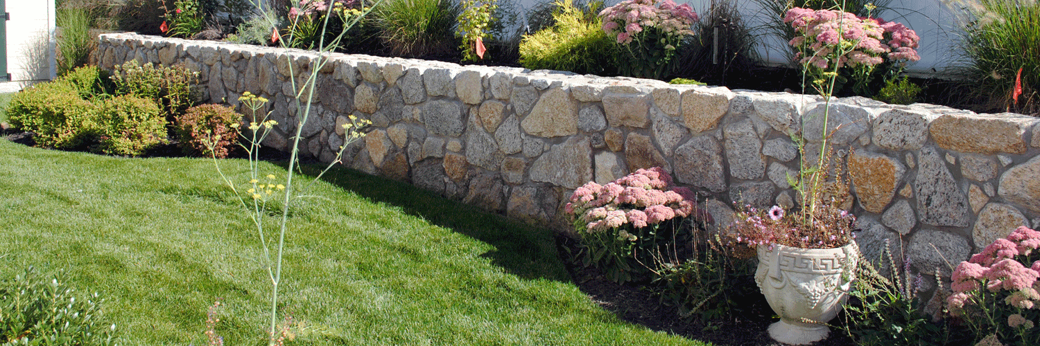 Landscape company design construction landscaping for Installing river rock landscaping